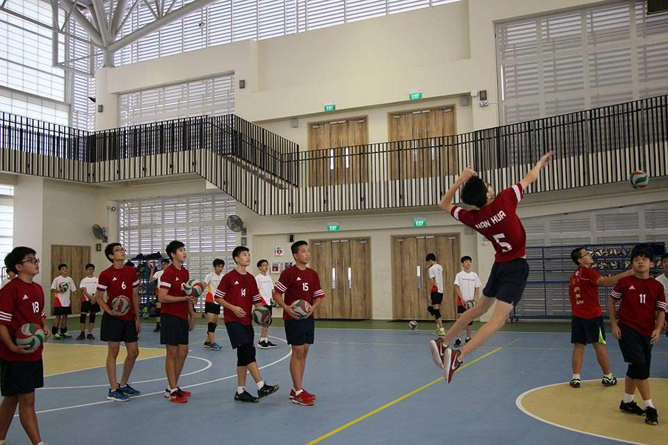 Warm up before a friendly match at Hwa Chong Institution.JPG