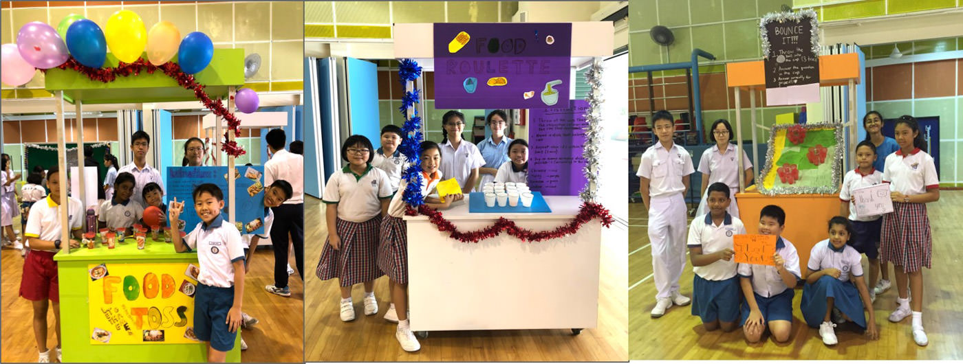 Teams posing proudly with their RHD booths.jpg