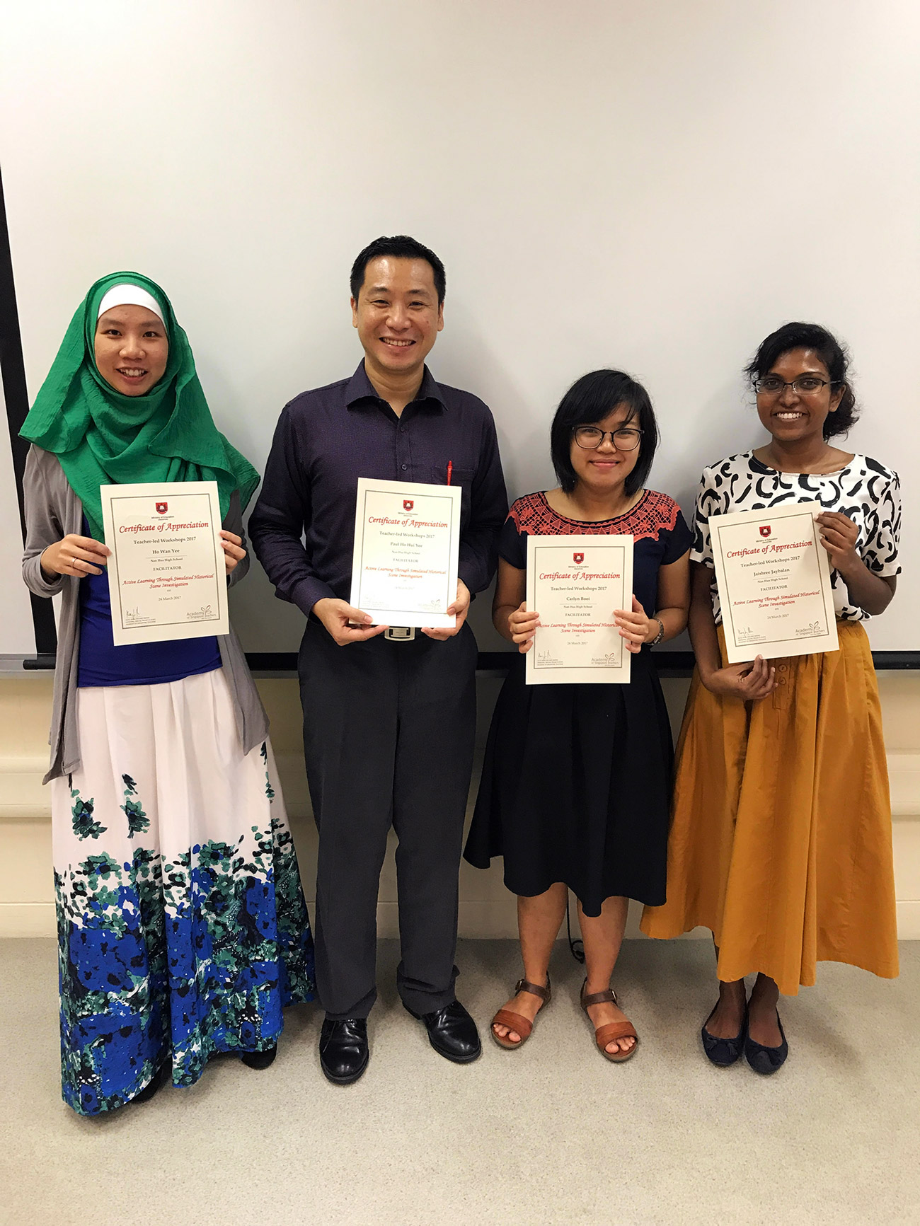 A-photograph-of-the-workshop-trainers-after-receiving-their-certificates-of-appreciation-from-AST.jpg